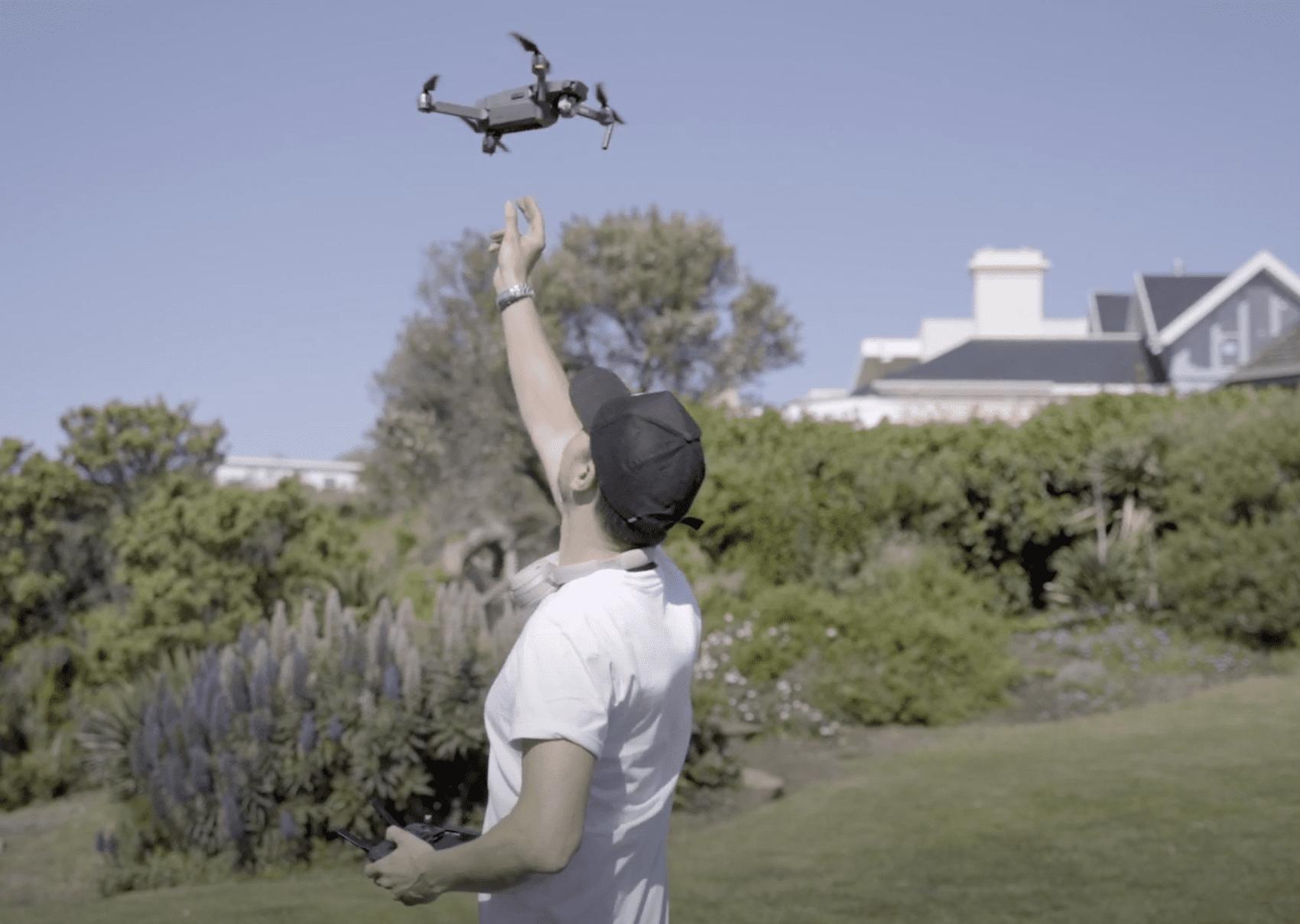 person releasing drone camera